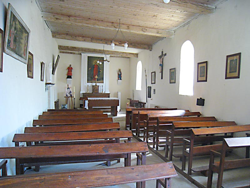 Inside view, looking towards the front of the chapel in Brouillet where De La Salle worshiped as a child.