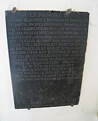 The plaque in memory of De La Salle's maternal grandfather, on the wall of the chapel in Brouillet where De La Salle worshiped as a child.