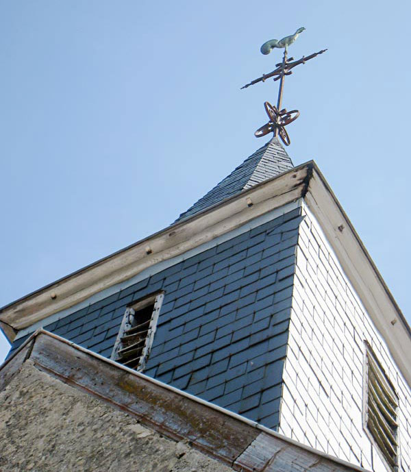 Tower and weather vane of the chapel in Brouillet where De La Salle worshiped as a child.