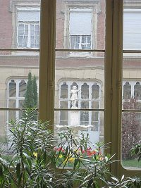 View out of the window in the hallway, looking into the central garden of the motherhouse in Reims of the Sisters of the Child Jesus
