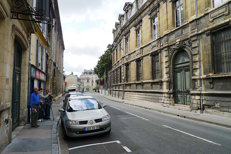 Looking down the street of the College des Bons Enfants. Our film crew and Br. Gerard are setting up for filming.