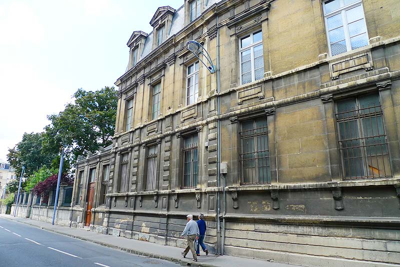 Detail of one of the building of the College des Bons Enfants. There is another entrance at the farther end of the building.