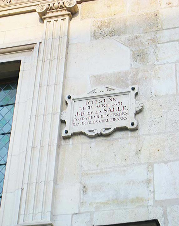 "Stone plaque on the facade of the Hotel de la Choche: ""Here I, is the birthplace, on April 30, 1651, of J B de La Salle, Founder of the Brothers of the Christian Schools."""