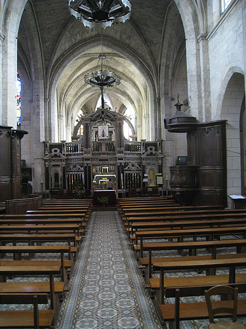 Inside the main church area of the church of Our Lady of Liesse (in Liesse, France).