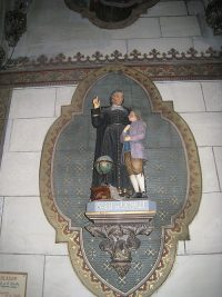 Statue of De La Salle in a side niche at the church of Our Lady of Liesse (in Liesse, France).