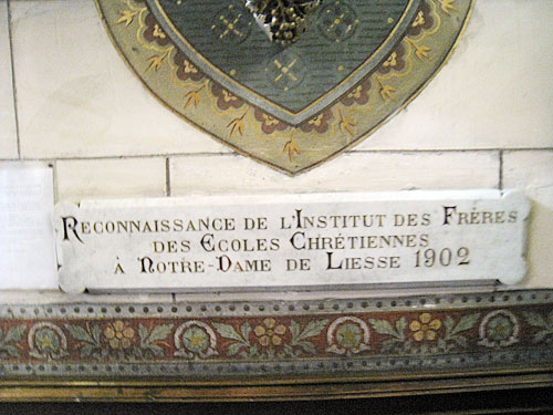 Dedicatory plaque in the side niche at the church of Our Lady of Liesse (in Liesse, France).
