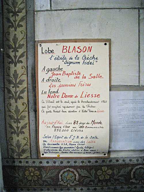 Sign in the side niche at the church of Our Lady of Liesse (in Liesse, France).