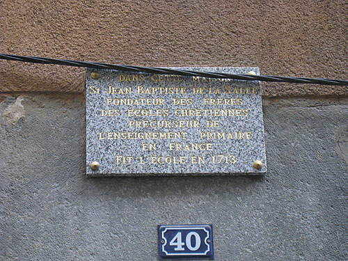 The plaque that's over the building where the Brothers first lived in Grenoble.