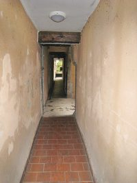 The passage down the corridor from the street in the house where the Brothers first lived in Grenoble.