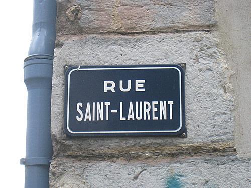 Street sign of the Rue Saint-Laurent in Grenoble, France.