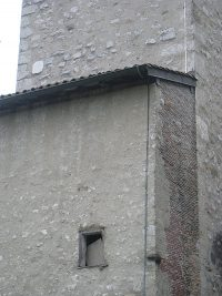 Detail of the Church of St. Laurent in Grenoble. Note the various kinds of building materials used at different times in its history.