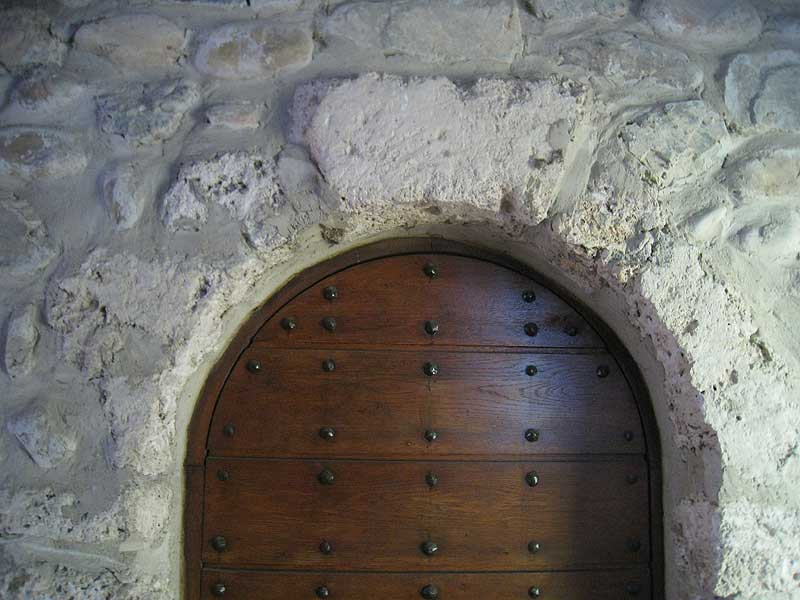 The headstone at one of the arched doorways at the Parmenie retreat center.