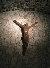 The crucifix against the front wall of the chapel at the Parmenie retreat center.