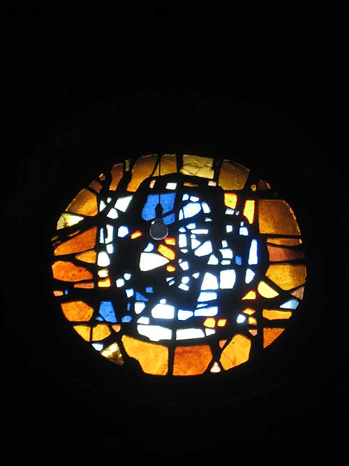 One of the stained glass windows in the chapel at the Parmenie retreat center.