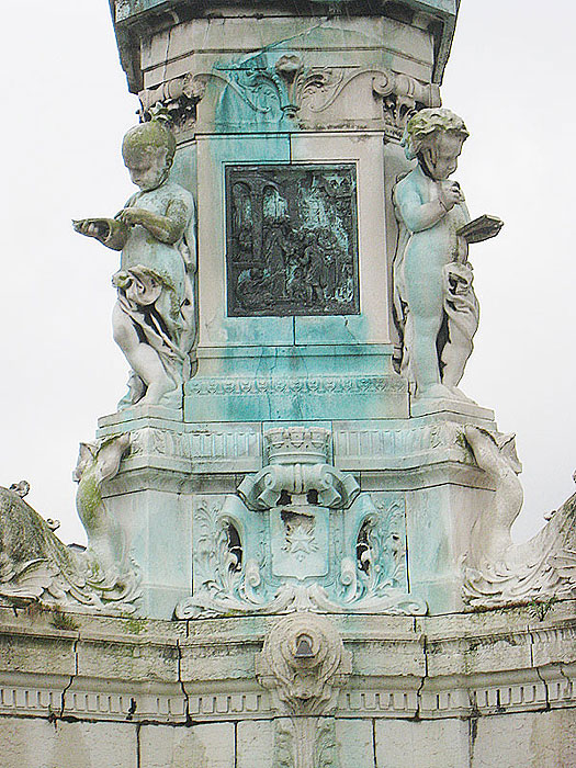 Detail from the statue of De La Salle at the Place St. Clement in Rouen, at the corner of the former St. Yon property.