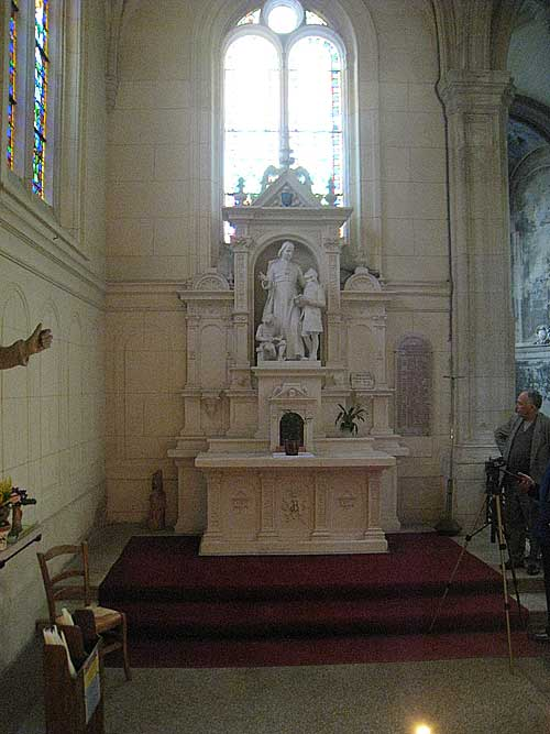 Stature and altar of De La Salle inside the more modern version of the Church of St. Sever, on top of the older church location where De La Salle was first buried.