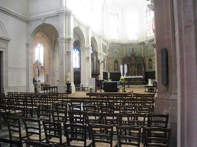 Nave of the more modern version of the Church of St. Sever, on top of the older church location where De La Salle was first buried. Side altar of De La Salle is on the left.
