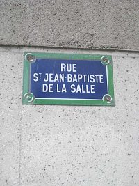 Sign on the wall of Rue St. John Baptist de La Salle
