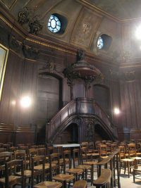 Pulpit against the back wall of the chapel of the Assumption in the church of Saint Sulpice.
