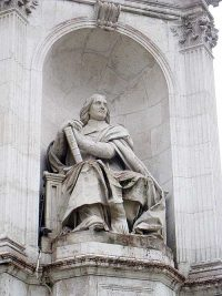 Detail of one of the four statues in the plaza in front of the church of Saint Sulpice.