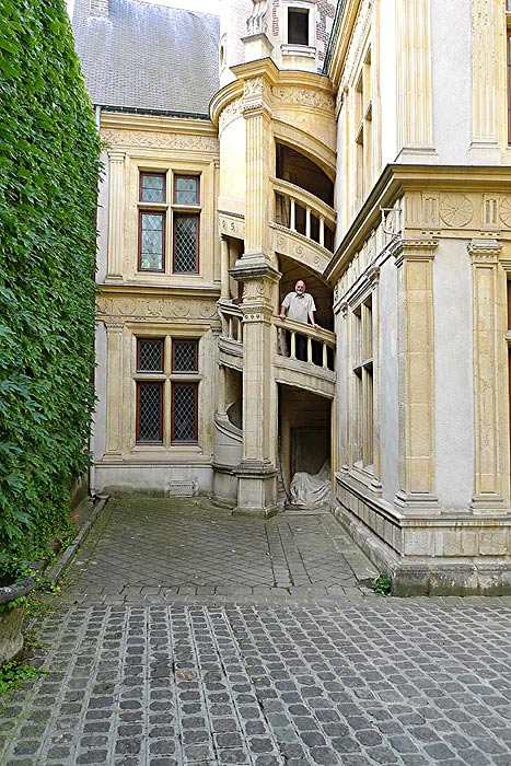 Circular staircase in the courtyard of the Hotel de la Cloche in Reims, France.