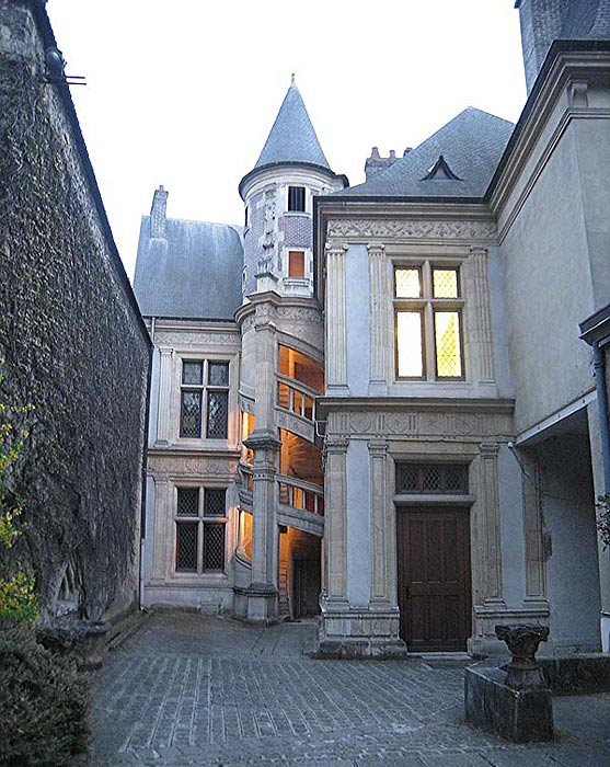 The back of the house at the courtyard of the Hotel de la Cloche in Reims, France, in the evening.