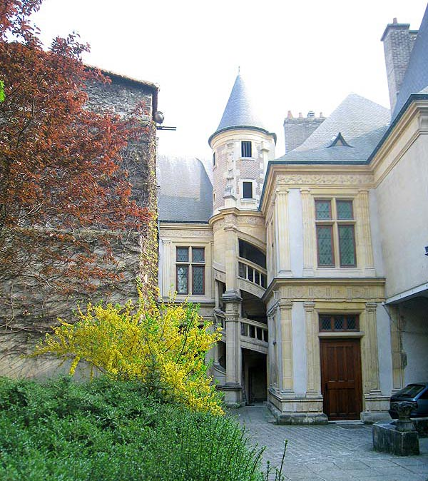 View of the back of the house from the courtyard of the Hotel de la Cloche in Reims, France.