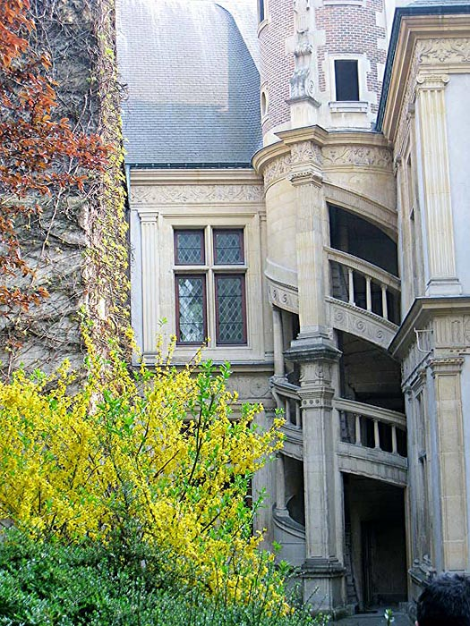 Close up of the architecture in the back courtyard of the Hotel de la Cloche in Reims, France.