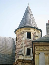 The tower above the staircase in the courtyard of the Hotel de La Cloche in Reims, France.