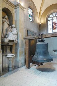 A bell from the original church of Saint Maurice in Reims, preserved inside.