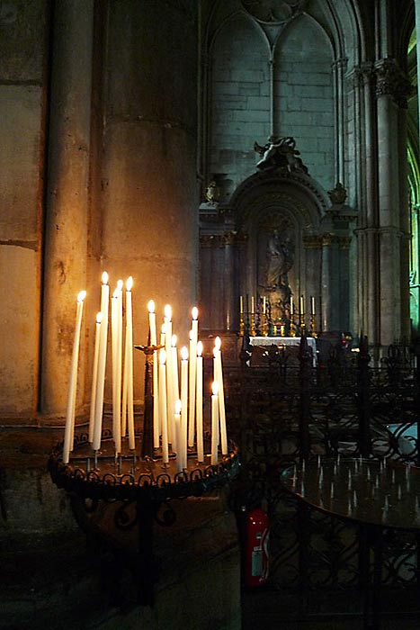 A devotional candle stand near the side chapel where De La Salle said his first Mass.