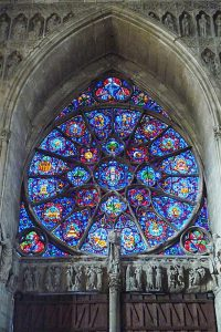 The ornate window in the south transept of the Reims Cathedral by Jacques Simon (1937), representing the resurrection.