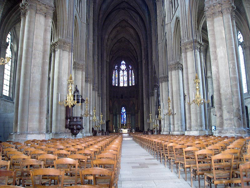 General view towards the front of the Reims Cathedral. One of the Chagall windows may be seen in the background.