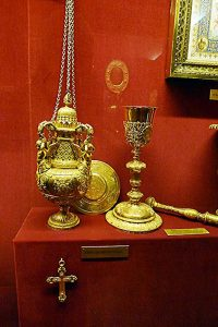 Sacred vessels and censer from the time of De La Salle, on display at the Palace du Tau.