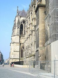 View from the front of the Reims Cathedral along one of the sides, showing the street access.