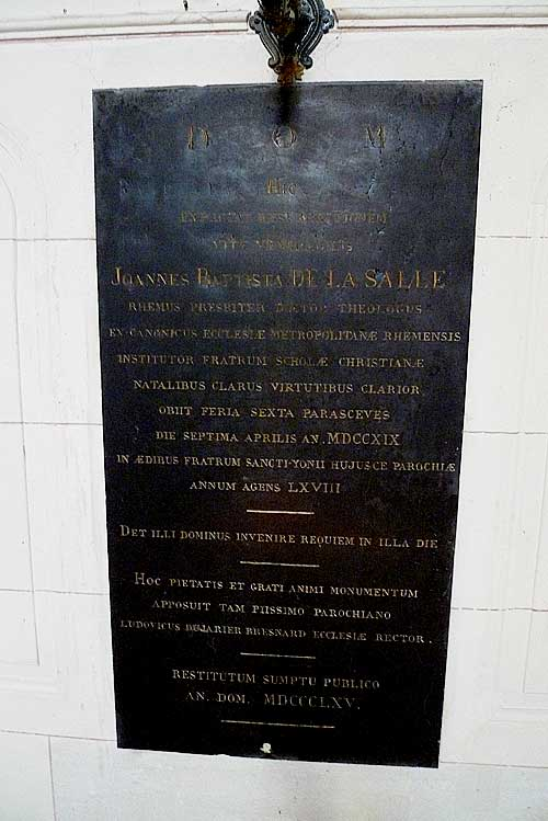 Plaque in De La Salle's side chapel of the more modern version of the Church of St. Sever, on top of the older church location where De La Salle was first buried.