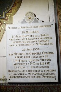 Plaque in the side niche at the church of Our Lady of Liesse (in Liesse, France) commemorating the visit of the leaders of the Institute in 1934.