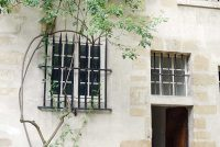Window and doorway facing the garden at the Carmelite Abbey in Paris.