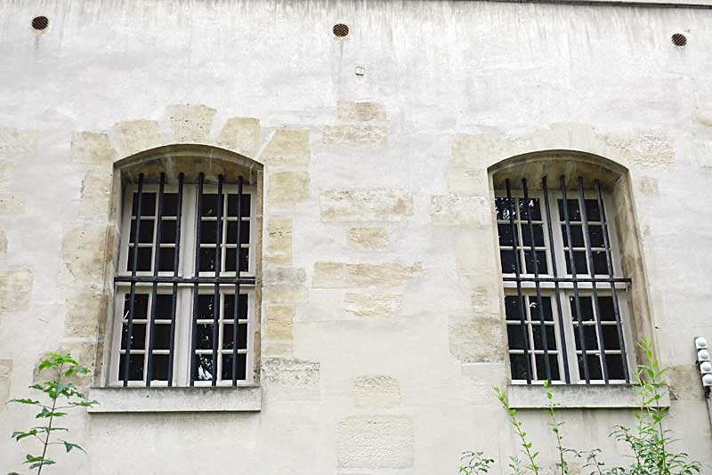 Windows facing the courtyard at the Carmelite Abbey in Paris.