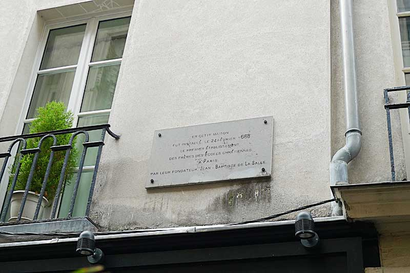 Commemorative plaque outside the building where the Lasallian school was located. • Rue Saint Jean-Baptiste De La Salle