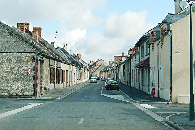 Side street in front of the church of Our Lady of Liesse (in Liesse, France).
