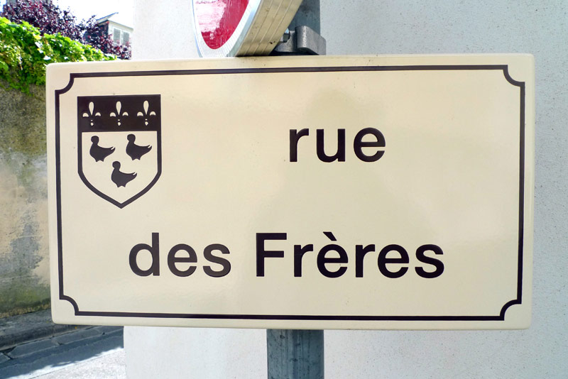 "Street sign for the ""Street of the Brothers"" in Laon, France."