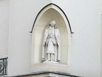 Statue on the wall of Rue St. John Baptist de La Salle