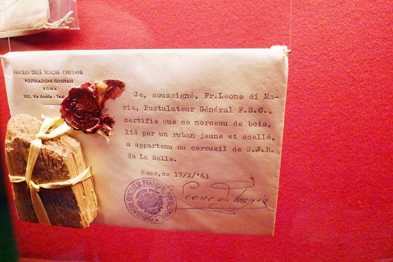Piece of the coffin in which De La Salle was buried, on display at the Hotel de la Cloche in Reims, France.