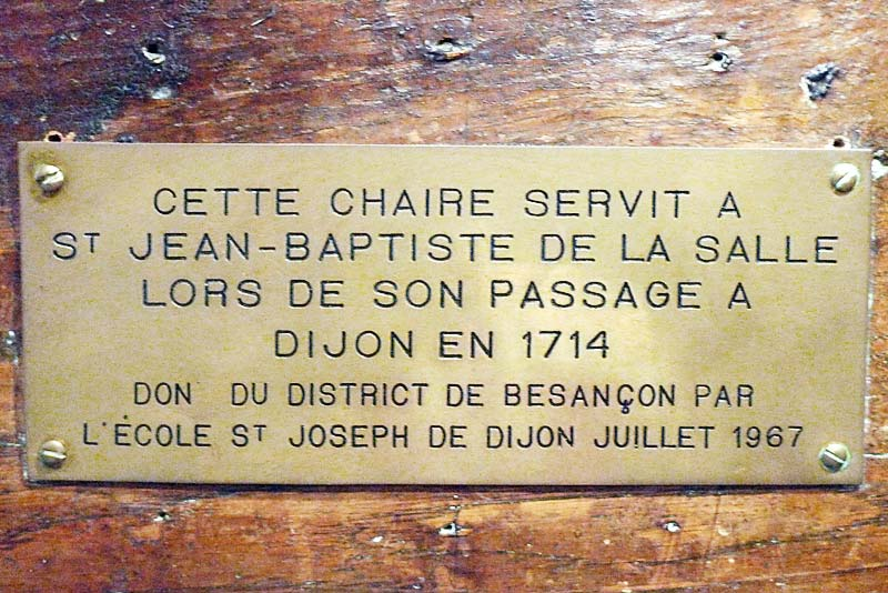 Sign on De La Salle's chair on display at the Hotel de la Cloche in Reims, France. It was used by him when he was in Dijon in 1714.